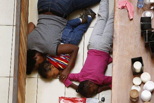 Mother and Children hide amid the fracas at Westgate Shopping Mall in Nairobi, Kenya