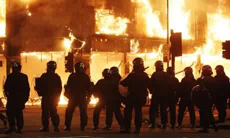 Police in Tottenham, north London, during the 2011 riots.