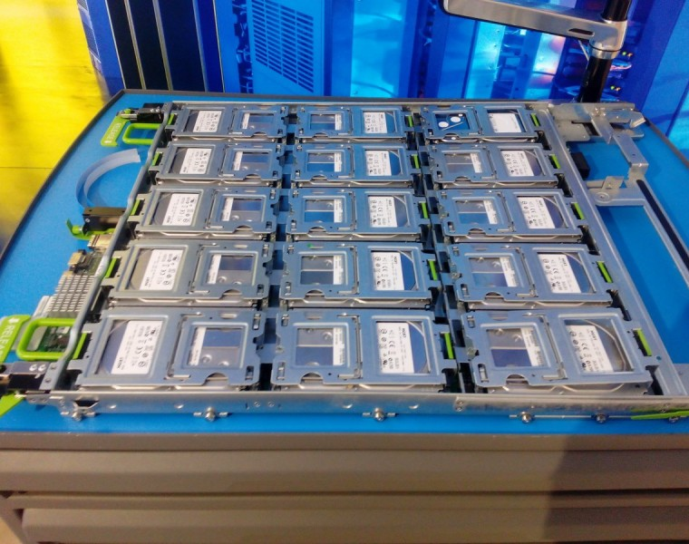 6: There are thousands of those trays in the average Facebook data center. Facebook's web server and storage designs use snaps and spring-loaded catches to hold components in place.