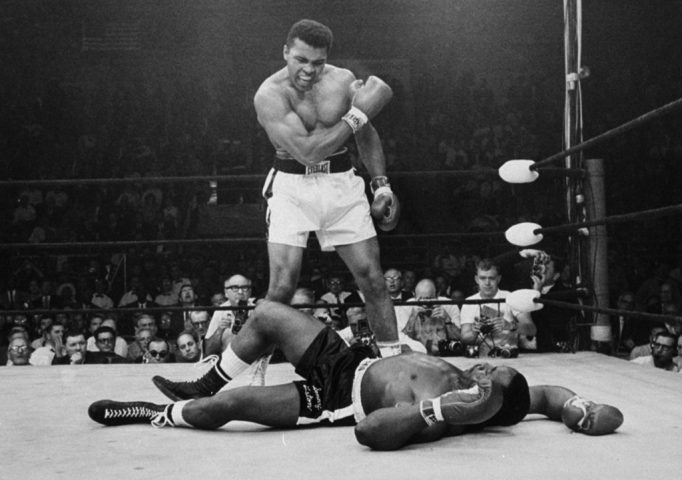 Heavyweight champion Muhammad Ali stands over fallen challenger Sonny Liston, shouting and gesturing shortly after dropping Liston with a short hard right to the jaw on May 25, 1965, in Lewiston, Maine. The bout lasted only one minute into the first round. AP Photo/John Rooney