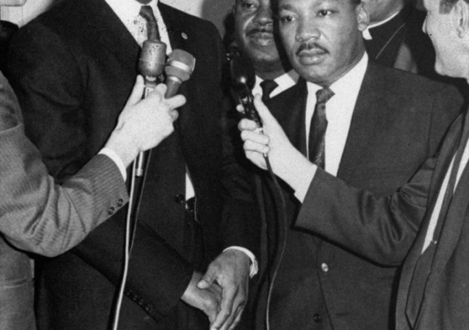 Muhammad Ali and Dr. Martin Luther King speak with reporters in Louisville, Ky., March 29, 1967. Ali was here for his court hearing to prevent his Army induction on April 28 in Houston. AP Photo