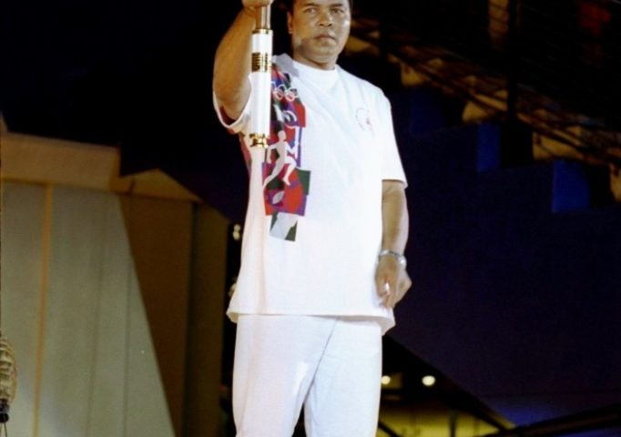 Muhammad Ali holds the torch before lighting the Olympic Flame during the Opening Ceremony of the 1996 Olympic Games in Atlanta. Michael Cooper/Getty Images