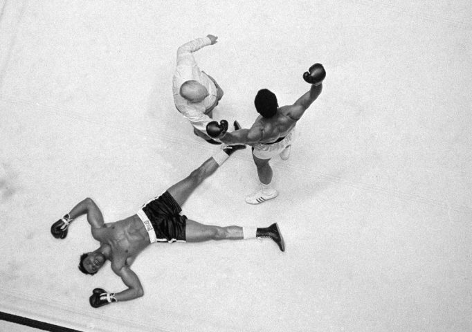 Cleveland Williams is spreadeagled on the canvas as referee Harry Kessler sends Muhammad Ali to a neutral corner during their heavyweight bout at the Astrodome in Houston, Nov. 14, 1966. AP Photo