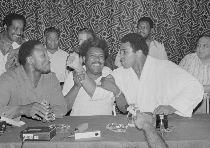 Joe Frazier sticks his chin out as Muhammad Ali points his fist towards him during a news conference in Kuala Lumpur, Malaysia on July 1, 1975 to promote the Thrilla in Manila title bout. AP Photo