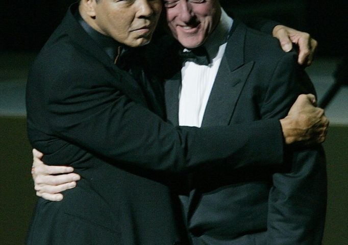 Muhammad Ali hugs former President Bill Clinton during the grand opening gala celebration for the Muhammad Ali Center, Nov. 19, 2005, in Louisville, Ky. AP Photo/Ed Reinke