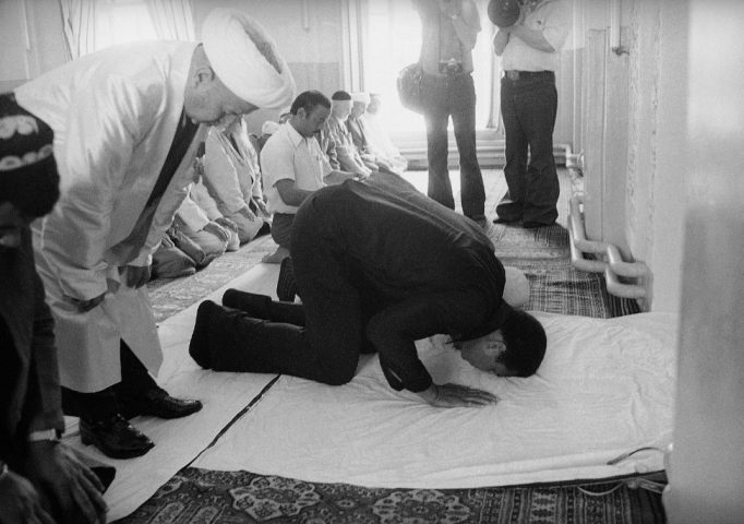 Muhammad Ali takes part in prayers at a Russian mosque during his 12-day visit to the Soviet Union, June 1978. AP Photo