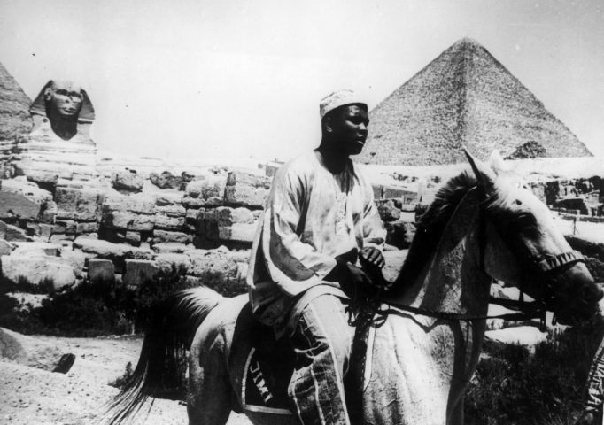 Heavyweight boxing champion Muhammad Ali riding a horse near the Sphinx and the pyramids at Giza, Egypt, 1964. Keystone/Hulton Archive/Getty Images