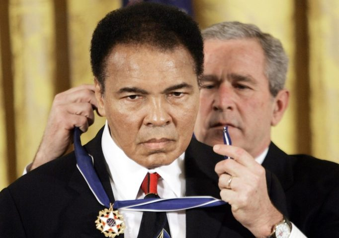 President Bush presents the Presidential Medal of Freedom, Nov. 9, 2005, to Muhammad Ali in the East Room of the White House. AP Photo/Evan Vucci