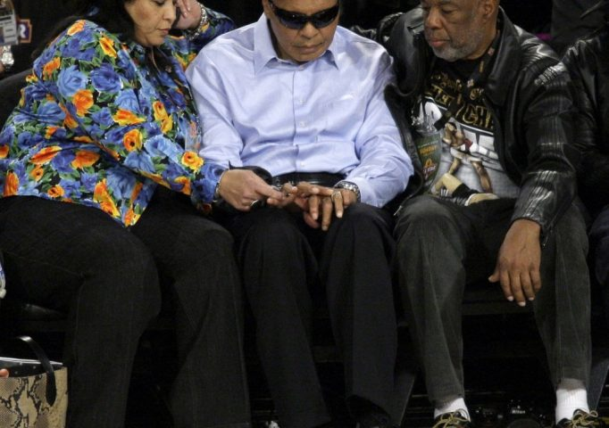 Muhammad Ali, with legendary photographer Howard Bingham, during the NBA All-Star basketball game, Feb. 15, 2009, in Phoenix. AP Photo/Matt Slocum