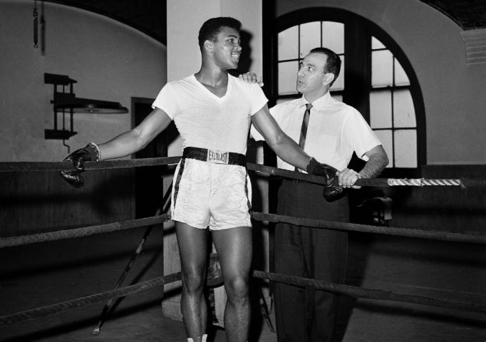 Cassius Clay with his trainer Angelo Dundee at City Parks Gym in New York, Feb. 8, 1962. AP Photo/Dan Grossi