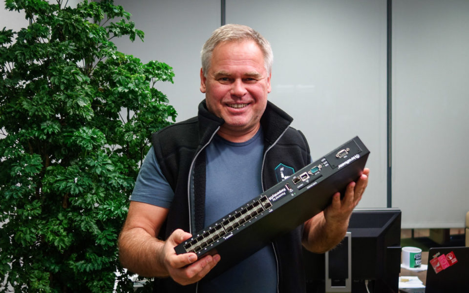 Eugene Kaspersky holding the Kaspersky OS Layer 3 Model.
